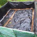 Mulch bin covered with black plastic.