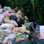 A hired Indigent segregating indiscriminately collected trash